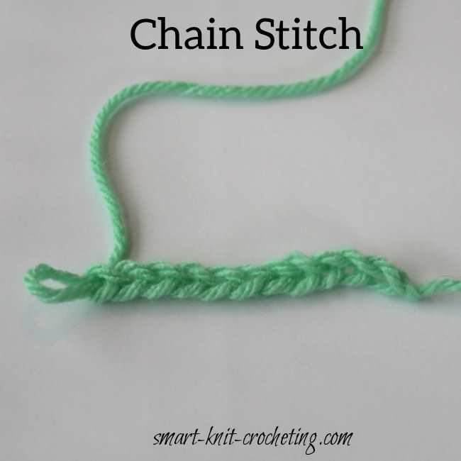 A crochet chain made in light green yarn.