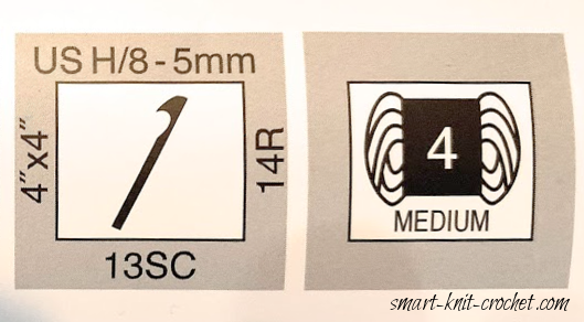 Part of a yarn label describing the thickness of the yarn and gauge recommendation