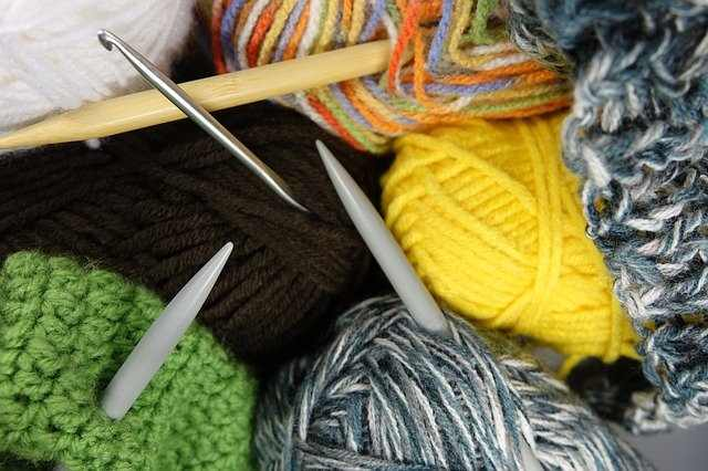 Yarn with knitting needles and crochet hooks